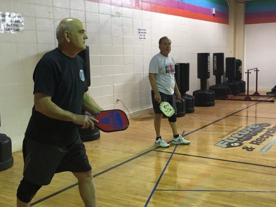 Steve Papas, 68, of Lacey, (l) and Allan Sherman 74, of Lacey compete in a spirited game of pickleball.
