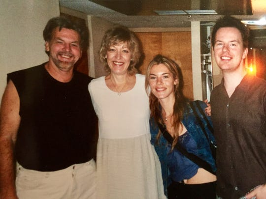Jennifer Paige poses with her family Christmas 1998,