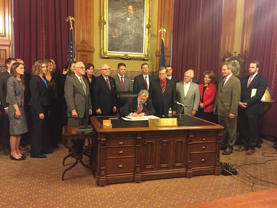 Gov. Terry Branstad signs into law House File 518,