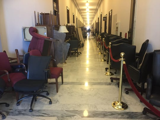 Furniture lined the hallway last week outside of the