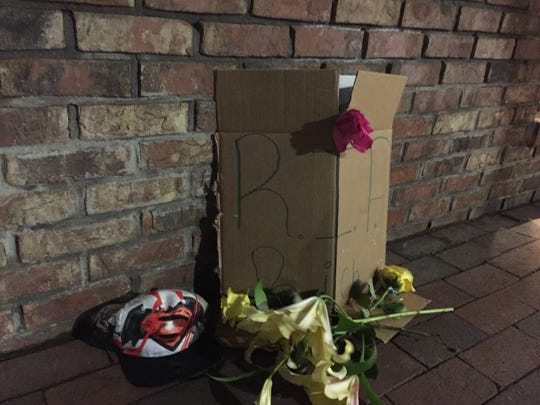 A memorial for Richard Medina, seen on Wednesday, March 29, at Church and Cherry Streets