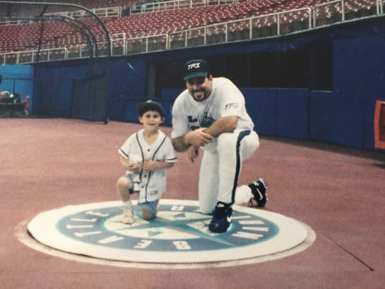 A young Matt Boyd at the Kingdome in Seattle with his father, Kurt.