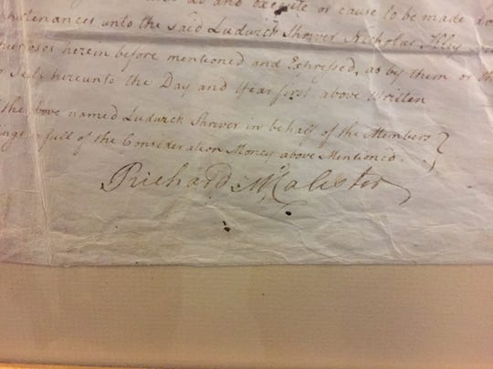 The signature of Hanover's founder Richard McAllister is still legible on the approximately 250-year-old deed to the land that once hosted the Emmanuel United Church of Christ congregation's first building. Hanover Borough was attempting to figure out this month who now owns a small German cemetery still located on the property.