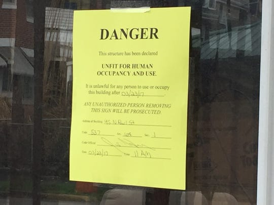 "A ""Danger"" sign is taped to the window of West York Feline Rescue. The property, located on the first block of North Pearl Street in West York, was condemned by borough officials on March 23."