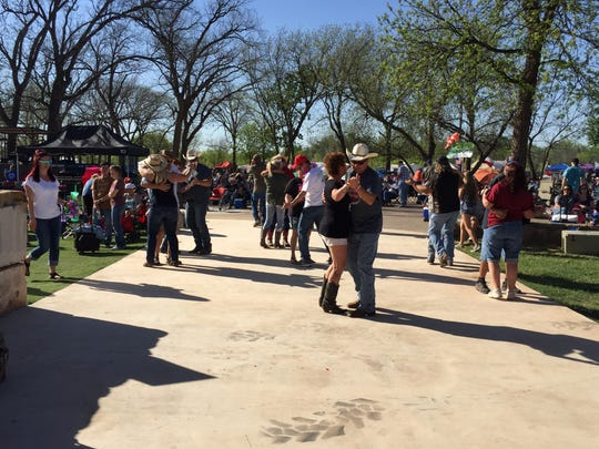 Couples dance at the 2017 Outlaws & Legends Music Fest
