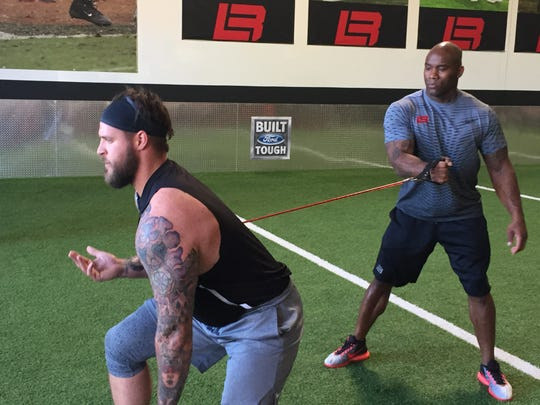 Lions tackle Taylor Decker, left, trains with former