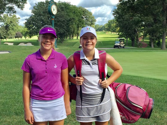 Pictured last year, Chloe Johnson (right) and her identical twin Faith have always competed in golf tournaments together.