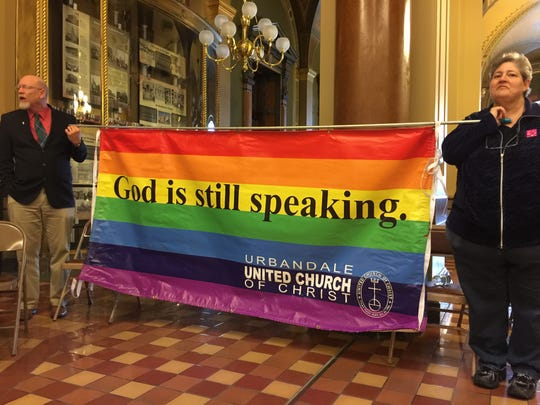 Rev. David Sickelka and Kathy Marean hold their rainbow flag inside the Capitol Rotunda Sunday. Sickelka and Marean said they wanted to show support.