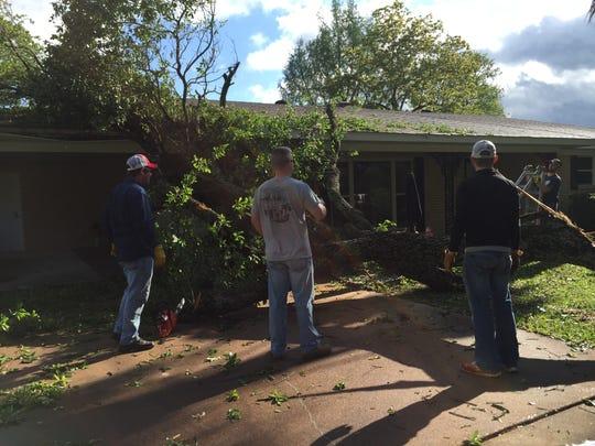 Calvary Baptist Church members begin removal of a massive