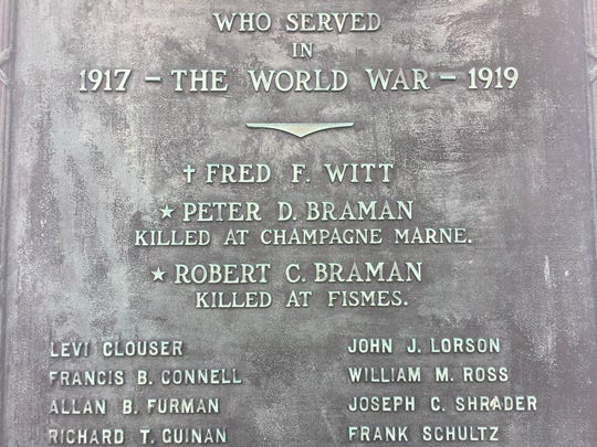 The Braman brothers are remembered at the East Penfield Baptist Church, their names starred on a plaque posted near the church's front door.