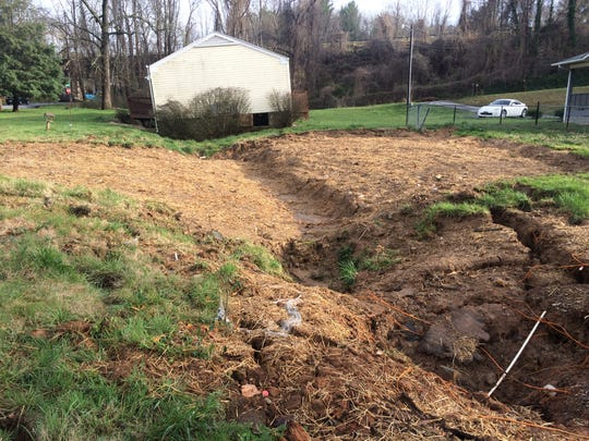Habitat for Humanity has removed one heavily damaged home on a sinkhole property on London Road, but another owned by someone else remains.