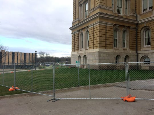 Fencing has been installed around the Iowa Capitol in some areas while repairs are made to the Capitol's dome.