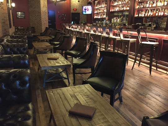More than 200 bourbons line the shelves at Wiseguy