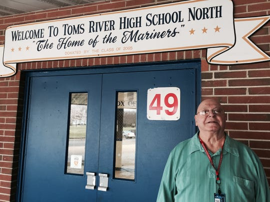 Raymond Massaro stands in front of Toms River North's entrance.