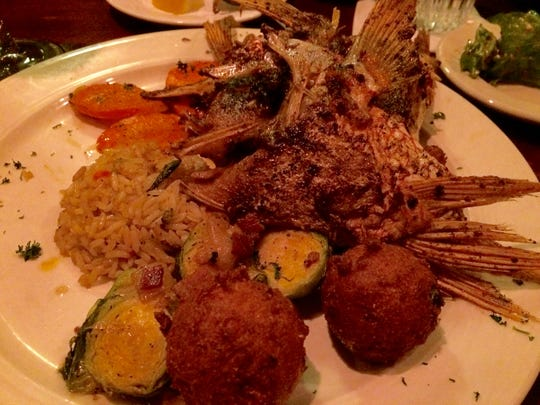 Grouper throats with hush puppies, brussels sprouts, rice and carrots.