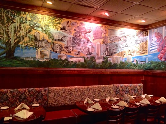 Georgio's decor includes a mural depicting Tallahassee.