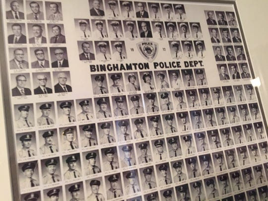 On the wall in Terry Heslin's Binghamton home hangs a photo of members of the Binghamton Police Department in 1972.