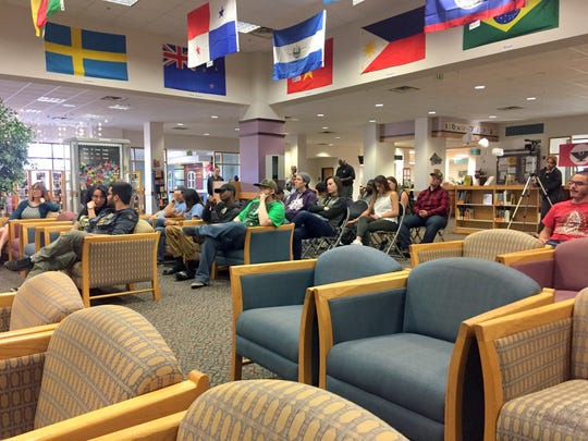 Students and community members sit during a forum Wednesday