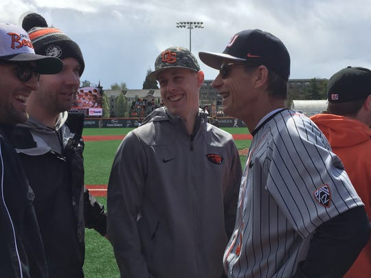 OSU baseball coach Pat Casey chats with players from the 2007 national championship team at Goss Stadium on April 8, 2017.
