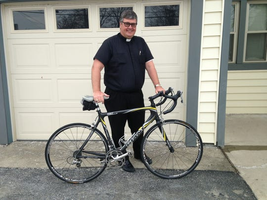 The Rev. Joseph Blenkle enjoys cycling in his spare