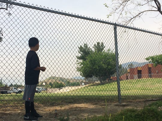 Jeffrey Imbriani, 7, looks toward North Park Elementary School in San Bernardino, California, on Tuesday, April 11, 2017. Jeffrey is a second-grader at the school and knew Jonathan Martinez, the boy killed Monday as a teacher's husband shot her.
