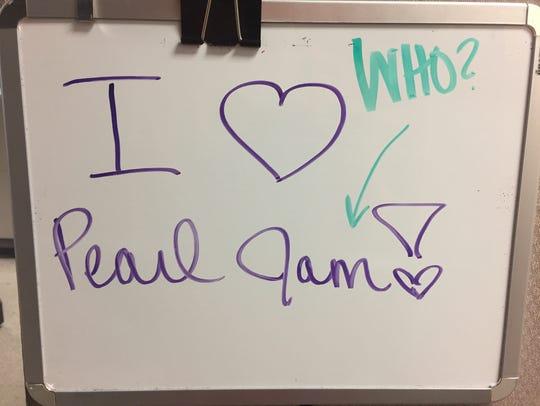 Katie wrote on Dustin's whiteboard. Dustin responded.