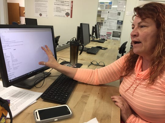 """Dixie State University criminal justice major Nanette Ariotti explains a student project titled """"Jessica and the Pool Boy"""" Tuesday, in which the class investigates tech clues in a fictional murder case."""