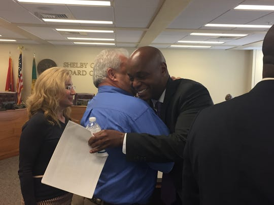 Shelby County Schools Superintendent Dorsey Hopson gets a hug from County Commissioner Terry Roland after presenting the school's capital funding request on April 12, 2017.