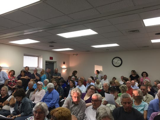 The Spring Garden municipal building was over capacity last Wednesday and the commissioners' meeting was moved to the Victory Fire Co. hall. At that meeting, the commissioners voted down a new proposed municipal complex. Christopher Dornblaser photo.