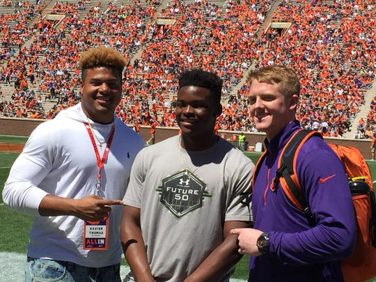 Xavier Thomas, Mike Jones Jr. and Jake Venables (from left) are all committed to play football at Clemson in 2018.