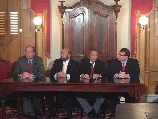 Ohio budget director Tim Keen, Speaker Cliff Rosenberger, Gov. John Kasich and Senate President Larry Obhof discuss cuts to Ohio's proposed budget.