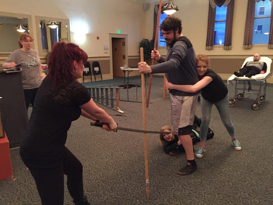 """Cast members rehearse a fight scene for Keizer Homegrown Theatre's presentation of """"Hearts like Fists."""" See the crime-fighting play April 28-30 or May 5-7 and 11-13 at Chemeketa Community College Auditorium. Cost is $15."""