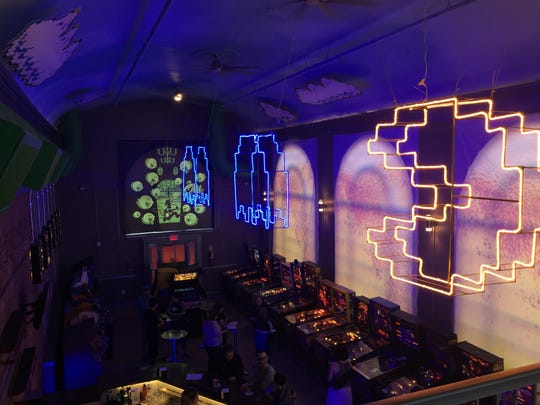 A view of The Grid Arcade & Bar from the second floor.
