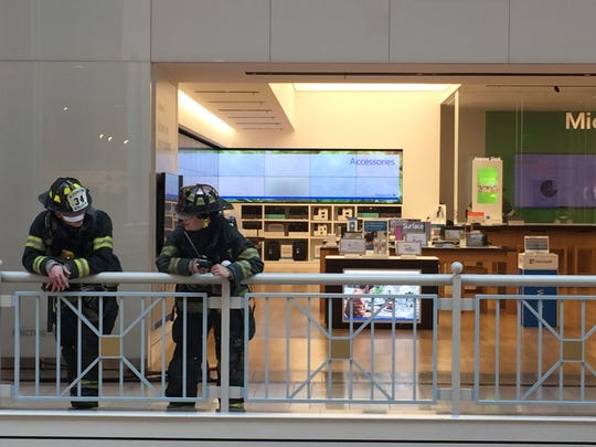 Firefighters outside of the Verizon and Microsoft stores on Friday after a foul smell began emanating from the second story.