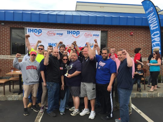 Flemington Fire Department with their IHOP trophy after winning Saturday's pancake-eating relay race.