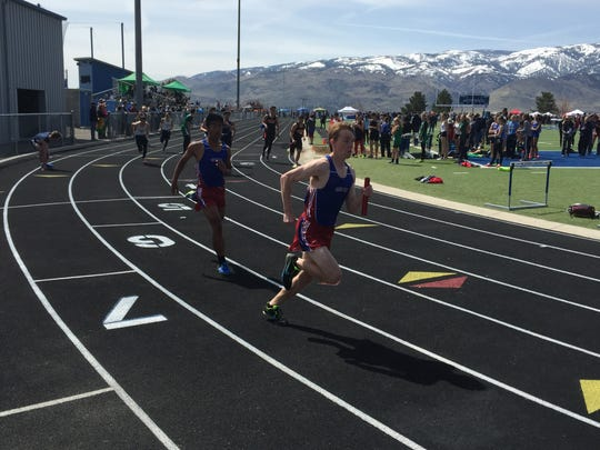 Boys race in the 4x200 relay Saturday at McQueen.