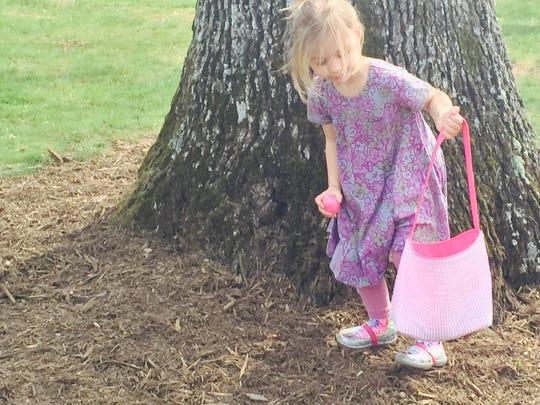 Caroline Ferko, 4, hunts for eggs before the Easter
