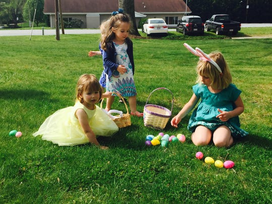 Four-year-old River Scherwitz, right, counts her Easter