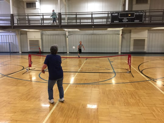 Linda Taylor, foreground, and Melba Lozano volley during a game of pickleball Monday at the Fremont Recreation Center.