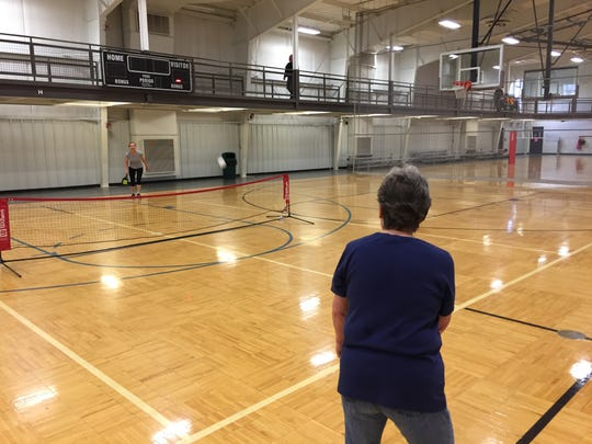 Linda Taylor, foreground and Melba Lozano play a game of pickleball at the Fremont Recreation Center.