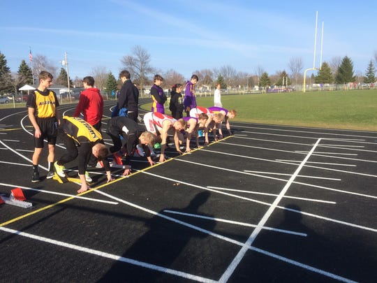 Runners get set in their blocks before a heat of the boys 100-meter dash at Kewaunee on April 13. Kewaunee has a new rubberized track after replacing its nearly 50-year-old one last summer.