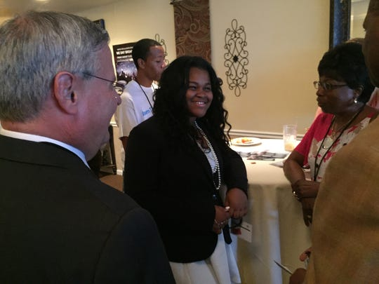 Imani Henry talks with supporters in 2015 during a party celebrating her appearance on a primetime TV special.