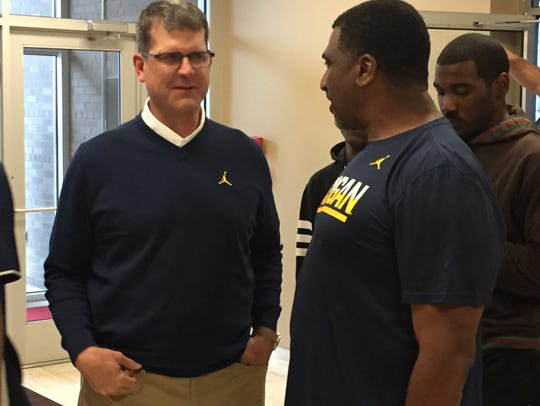 Jim Harbaugh, left, and Horatio Williams at the Horatio