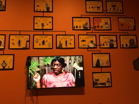 """One of Kalup Linzy's pieces, """"The Queen Rose Family Tree,"""" stretches across two walls at Bob Rauschenberg Gallery and shows photos of the 83 characters in Katessa Brasswell's family tree. Most of those characters (including Katessa) are played by Linzy, but many are also played by his sister, his cousins, nieces, nephews and other people (including REM singer Michael Stipe)."""