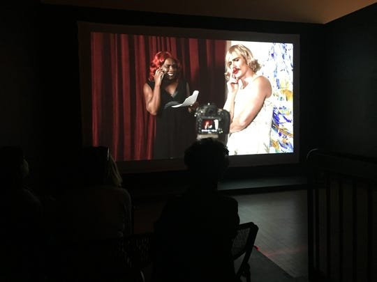 """An audience watches James Franco and Kalup Linzy in a scene from """"Ozara and Katessa."""""""