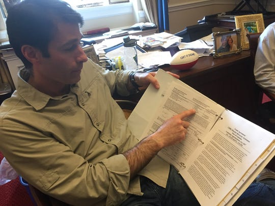 Rep. Garret Graves, R-La., shows the binder where he has kept track of the flood recovery aid process between the state and the Department of Housing and Urban Development.