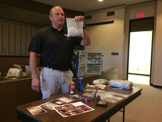 RPD Sgt. Scott Crull displays a bag of heroin worth an estimated $40,000 as he shows city landlords the types of drugs and drug paraphernalia they might find in their properties.