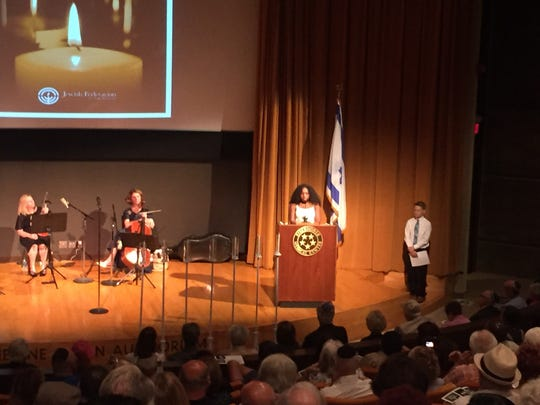 Essay contest second-place finisher Camille Wilson, a tenth-grade student, reads her essay at a Holocaust Remembrance Day ceremony on April 23, 2017.