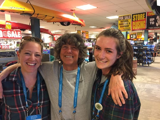 Kristina Suddard, Sherry Ober and Marley Nahum (left to right) work at the Eastern Mountain Sports in South Burlington.