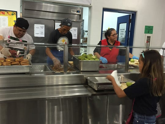 Ordot Chalan Pago Elementary School cook Jonathan Camacho, left, baker Carl Suzuki, center, and assistant cook Doris Quiroz, right, help serve meals to students on Tuesday. The federal program allowing students to eat breakfast and lunch for free, just like the one at Ordot Chalan Pago Elementary, won't be expanded next academic year because of a lack of local matching fund.